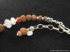 nw-11-i-rosekwarts-neolithische-kwarts-zilver-boeddha-amulet-883x662