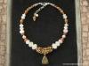 nw-11-j-rosekwarts-neolithische-kwarts-zilver-boeddha-amulet-883x662